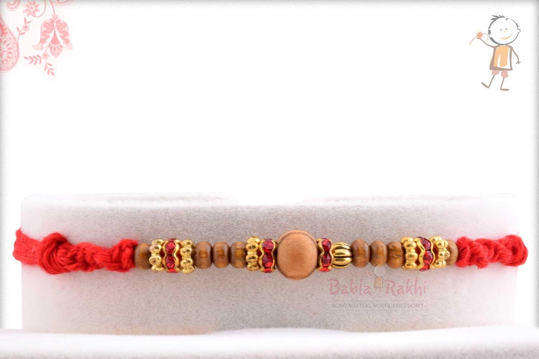Sandalwood Beads Rakhi with Diamond and Golden Rings 1