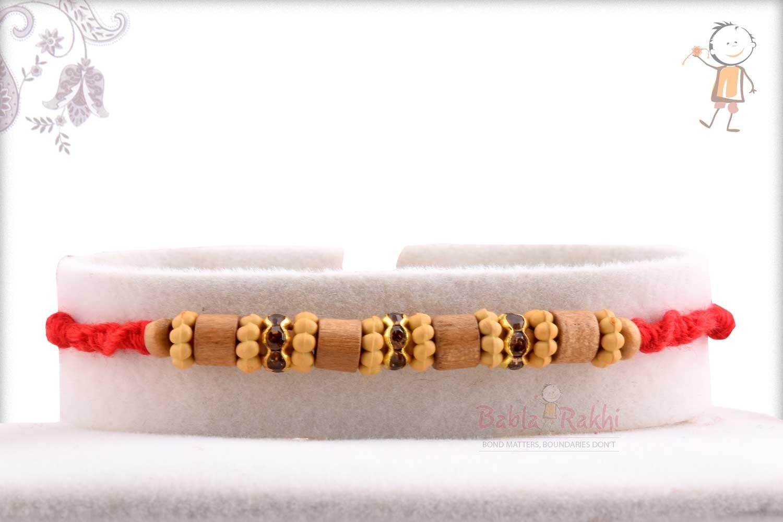 Beautiful Round Cut Sandalwood Beads Rakhi 1
