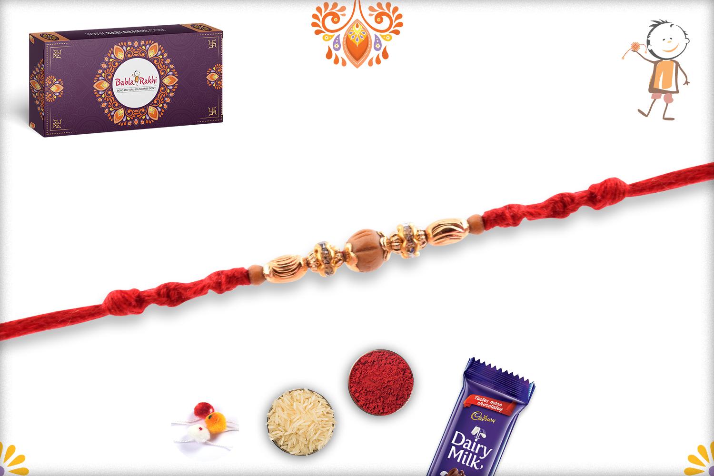 Exclusive Golden Designer Rakhi with Maroon Thread 2