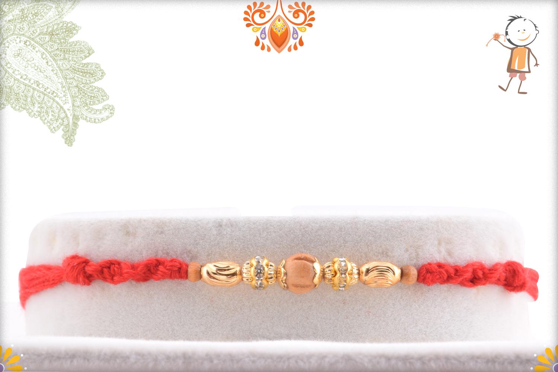 Exclusive Golden Designer Rakhi with Maroon Thread 1