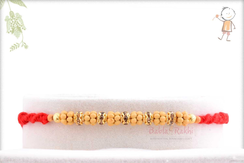 Simple Diamond Rings with Golden Beads Rakhi 1