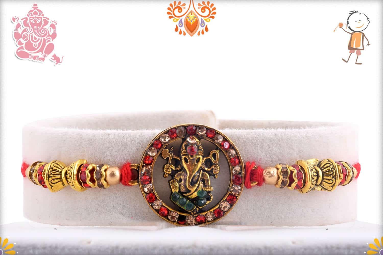 Antique Ganeshji Rakhi with Red Diamonds | Send Rakhi Gifts Online 1