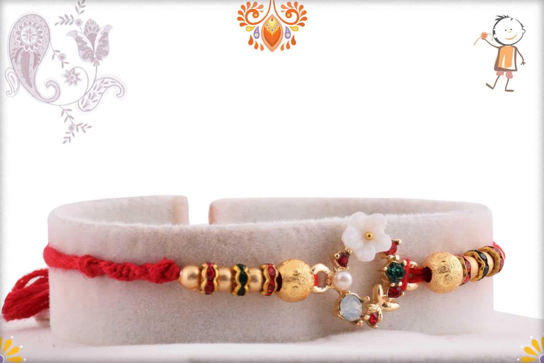 Special White Flower Rakhi with Diamonds and Golden Beads   Send Rakhi Gifts Online 2