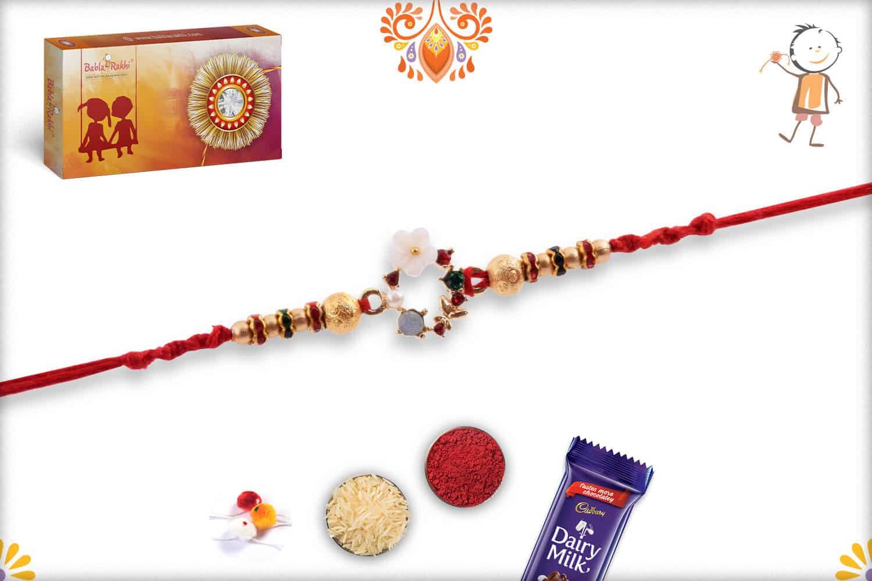 Special White Flower Rakhi with Diamonds and Golden Beads   Send Rakhi Gifts Online 3