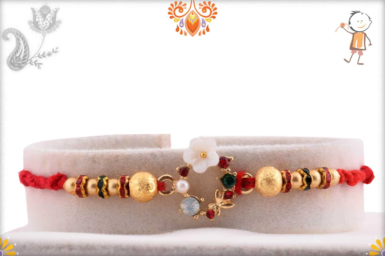 Special White Flower Rakhi with Diamonds and Golden Beads   Send Rakhi Gifts Online 1