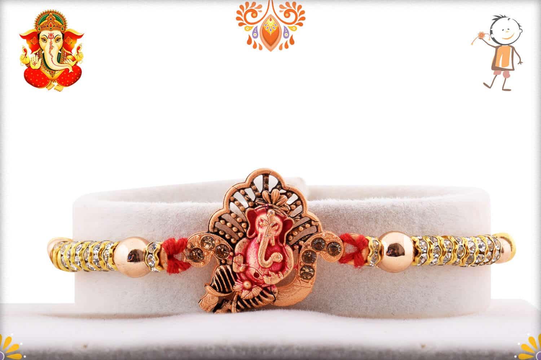 Divine Ganpati Rakhi with Diamonds and Golden Beads | Send Rakhi Gifts Online 1
