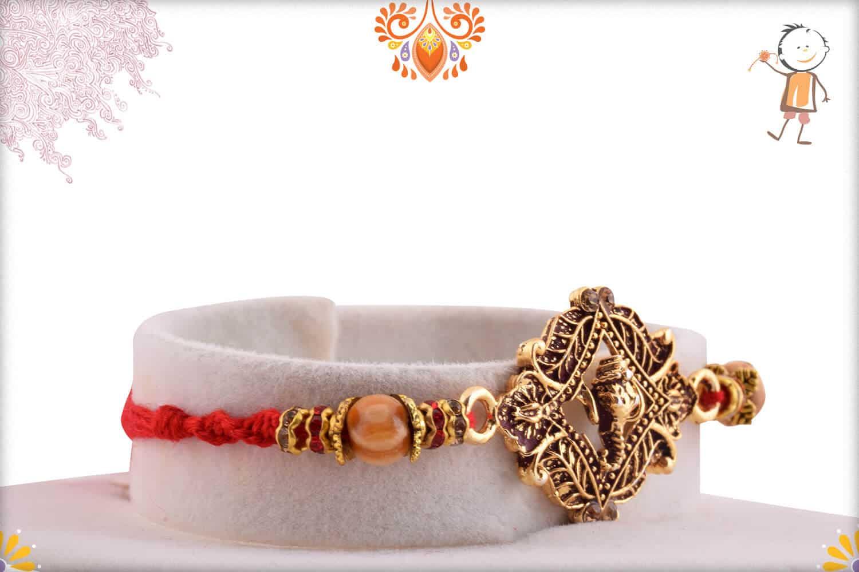 Auspicious Ganesha Rakhi with Sandalwood Beads   Send Rakhi Gifts Online 2