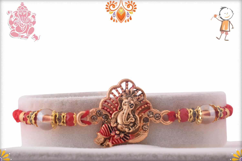 Divine Ganesh Rakhi with Diamonds and Red Beads | Send Rakhi Gifts Online 1