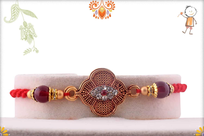 Exclusive Rakhi with Maroon Beads and Diamonds | Send Rakhi Gifts Online 1
