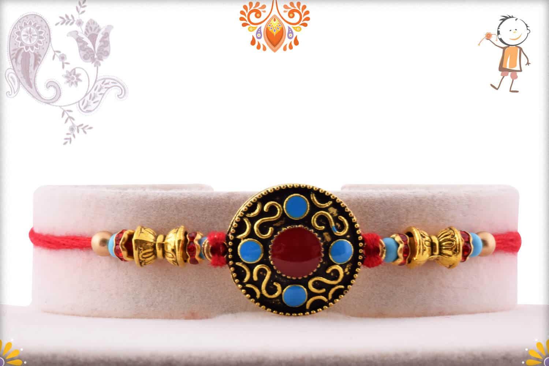 Designer Round Rakhi with Blue and Red Bead   Send Rakhi Gifts Online 1