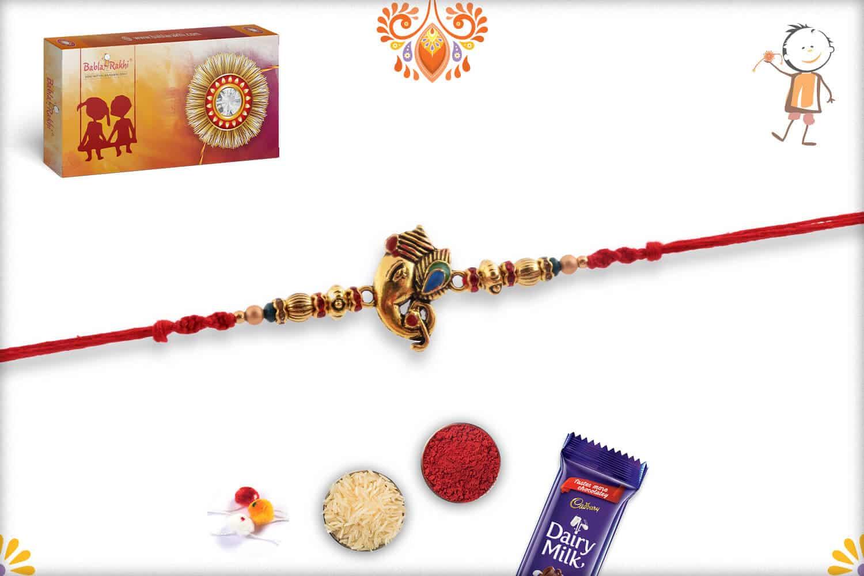 Meenakari Ganeshji Golden Rakhi with Diamonds Rings   Send Rakhi Gifts Online 2