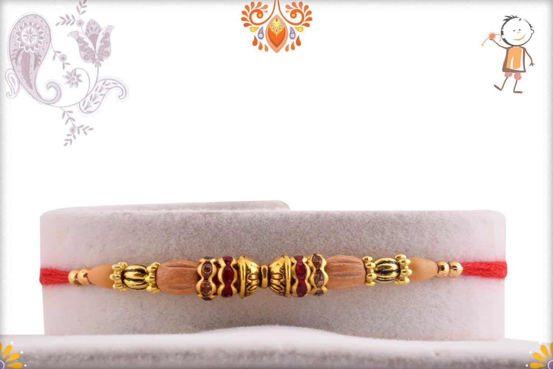 Handcrafted Damaroo Rakhi with Sandalwood Beads | Send Rakhi Gifts Online 1