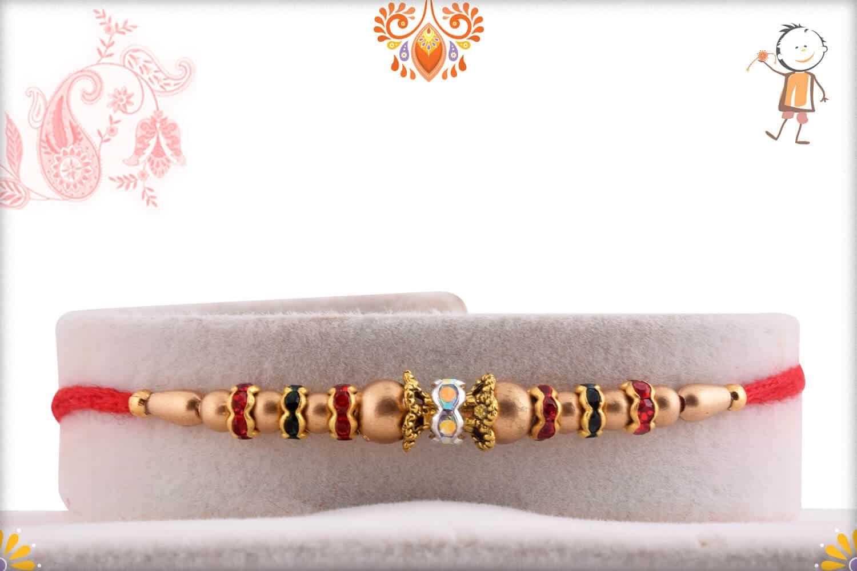 Delicate Golden Beads Rakh with Multi-color Diamonds   Send Rakhi Gifts Online 1