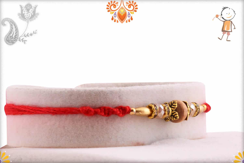 Handcrafted Sandalwood Beads Rakhi with Golden Beads   Send Rakhi Gifts Online 2