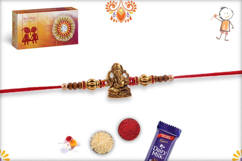 Golden Ganeshji Rakhi with Diamond-cut Beads   Send Rakhi Gifts Online 2