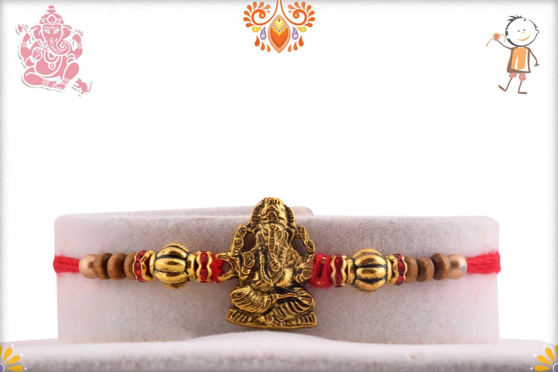 Golden Ganeshji Rakhi with Diamond-cut Beads   Send Rakhi Gifts Online 1