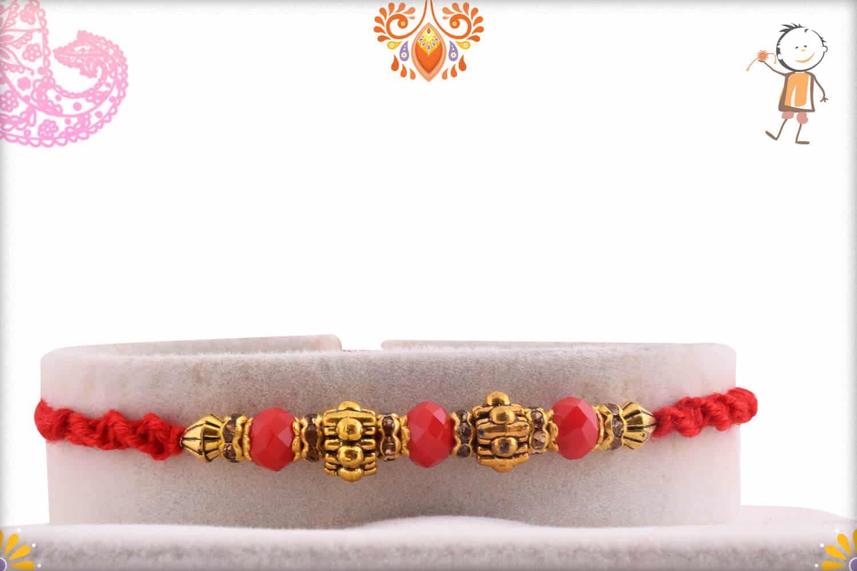 Designer Golden Beads Rakhi with Red Stone Beads 1