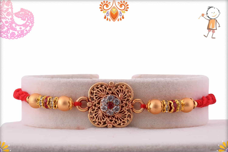 Designer Clover Shape Golden Rakhi with Diamonds 1
