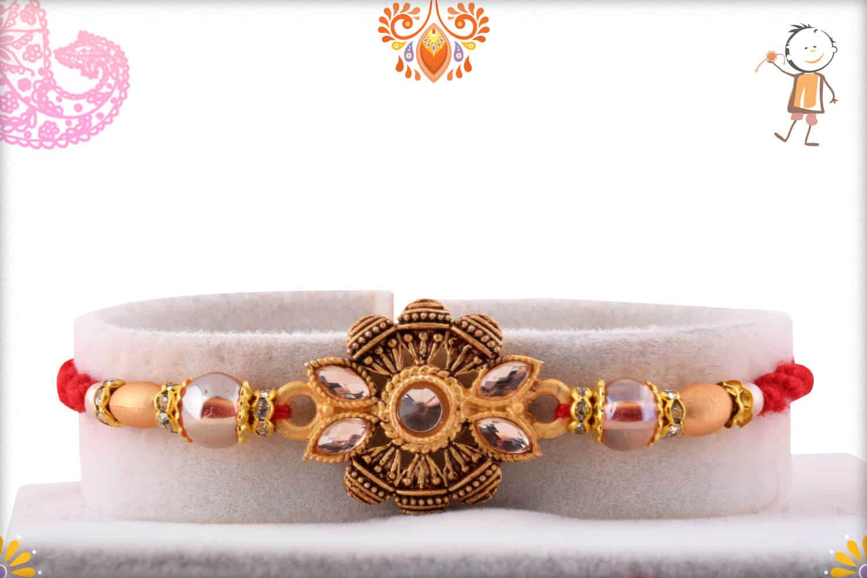 Unique Handcrafted Golden Rakhi with Beads | Send Rakhi Gifts Online 1