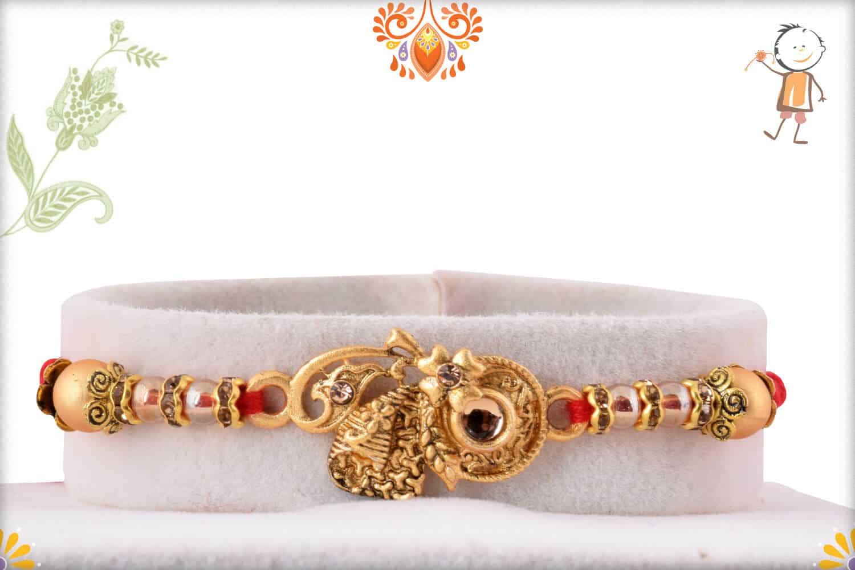 Unique Shape Golden Rakhi with Beads | Send Rakhi Gifts Online 1