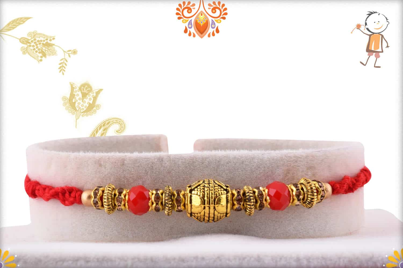 Traditional Golden Rakhi with Red Beads | Send Rakhi Gifts Online 1