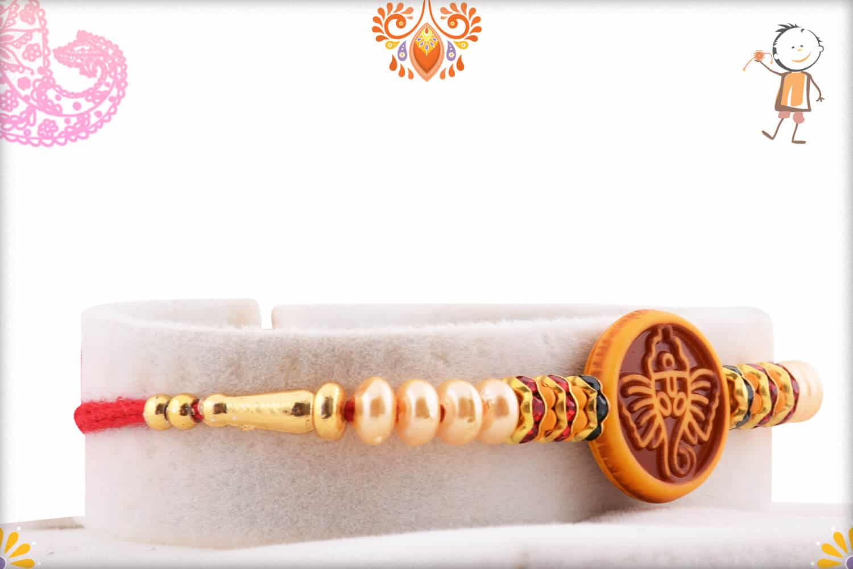 Divine Ganesh Rakhi with Beautful Pearls | Send Rakhi Gifts Online 2
