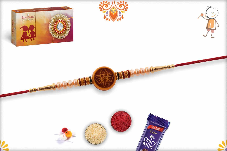 Divine Ganesh Rakhi with Beautful Pearls | Send Rakhi Gifts Online 3