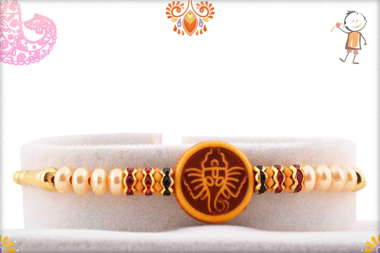 Divine Ganesh Rakhi with Beautful Pearls | Send Rakhi Gifts Online 1
