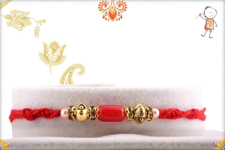 Oval Shape Red Bead Rakhi with Designer Beads | Send Rakhi Gifts Online 1