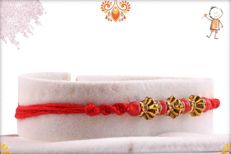 Designer Antique Beads Rakhi with Red Crystal Beads   Send Rakhi Gifts Online 2