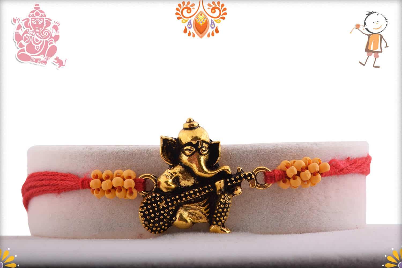 Antique Guitar Ganpati Rakhi with Small Beads | Send Rakhi Gifts Online 1