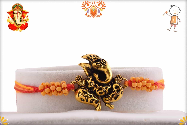 Antique Craved Ganpati Rakhi | Send Rakhi Gifts Online 1