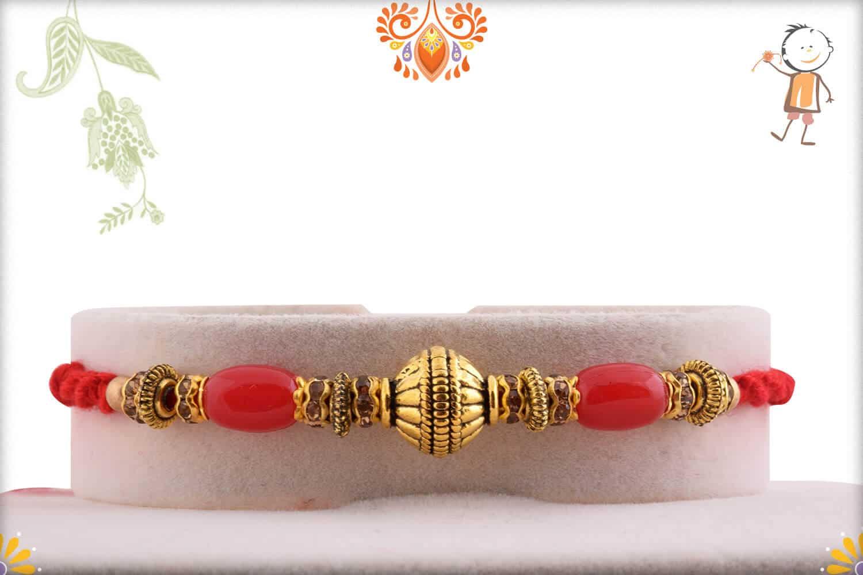 Designer Copper Bead Rakhi with Red Oval Beads | Send Rakhi Gifts Online 1