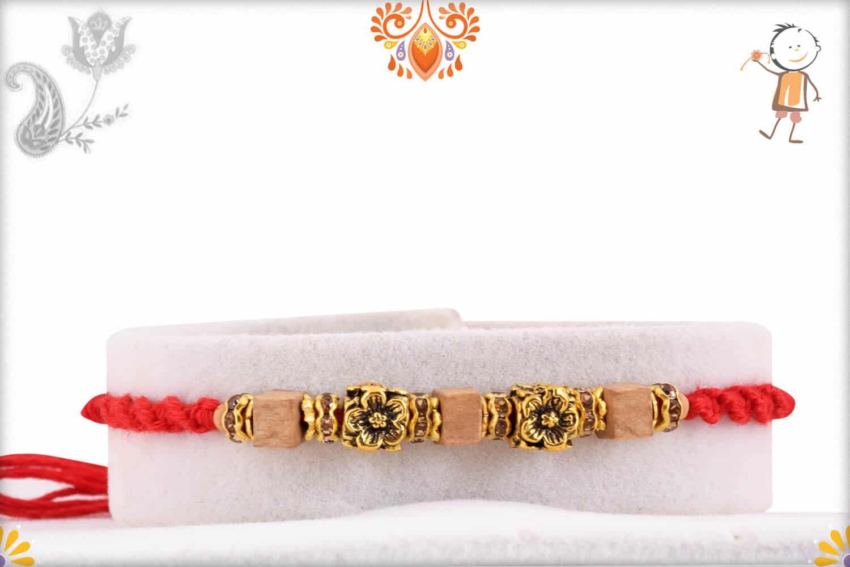 Exclusive Antique Flower Bead Rakhi with Square Sandalwood Beads | Send Rakhi Gifts Online 1