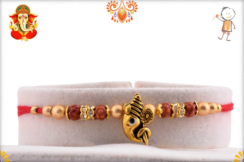 Divine Ganesh Rakhi with Golden Beads and Diamonds   Send Rakhi Gifts Online 1