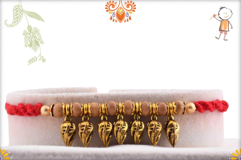 Hanging Leaves Rakhi with Sandalwood Beads | Send Rakhi Gifts Online 1