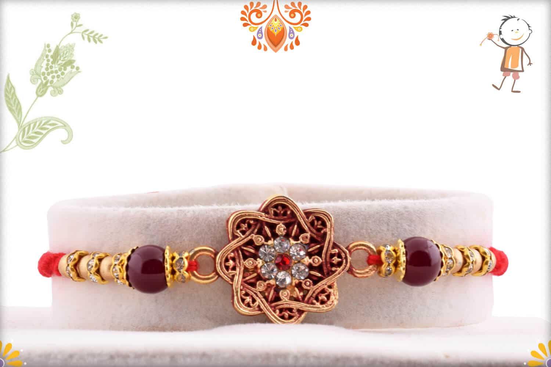 Diamond Chakra Rakhi with Golden Beads | Send Rakhi Gifts Online 1