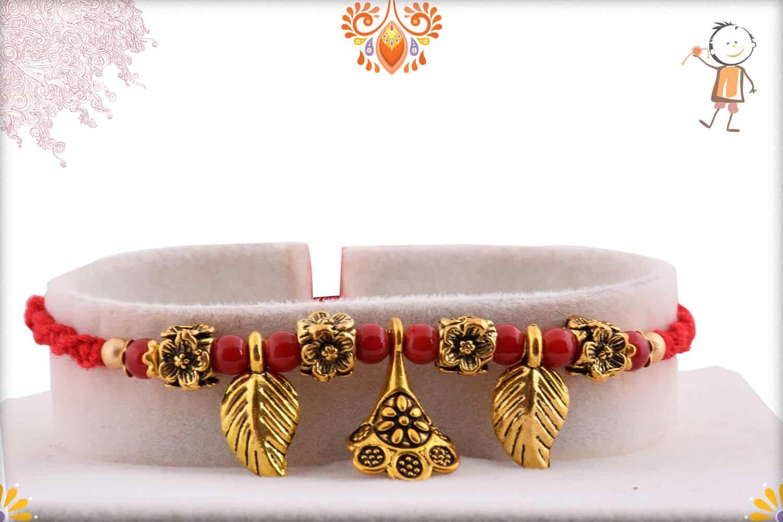 Hanging Leaves Rakhi with Flower Beads | Send Rakhi Gifts Online 1