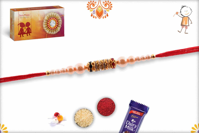 Dazzling Diamond Rings with Pearl Rakhi | Send Rakhi Gifts Online 2