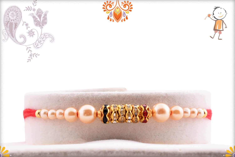 Dazzling Diamond Rings with Pearl Rakhi | Send Rakhi Gifts Online 1