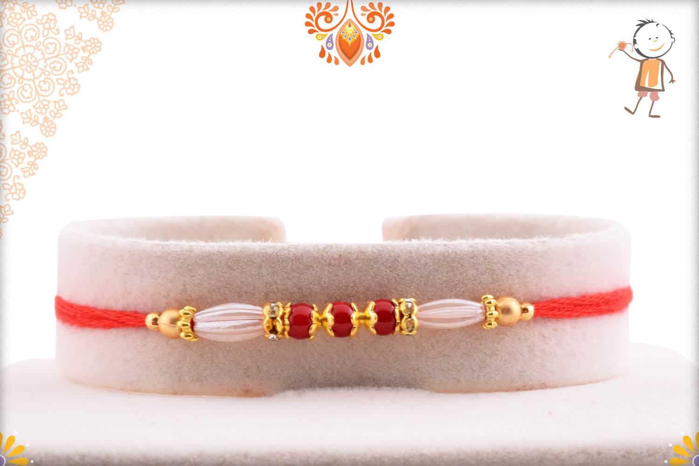 Premium Red Bead with Designer Pearl Rakhi   Send Rakhi Gifts Online 1