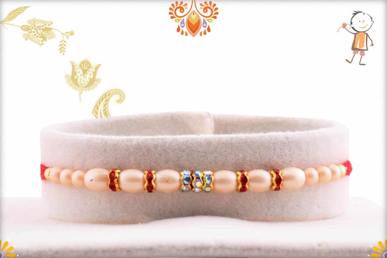 Shining Diamond Rings with Pearl Rakhi | Send Rakhi Gifts Online 1
