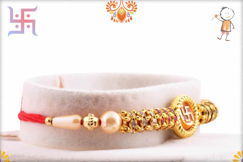OM with Swastik Pearl Rakhi | Send Rakhi Gifts Online 2