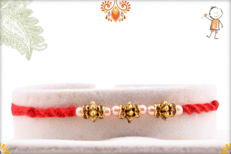 Designer Metal Beads with Pearl Rakhi | Send Rakhi Gifts Online 1