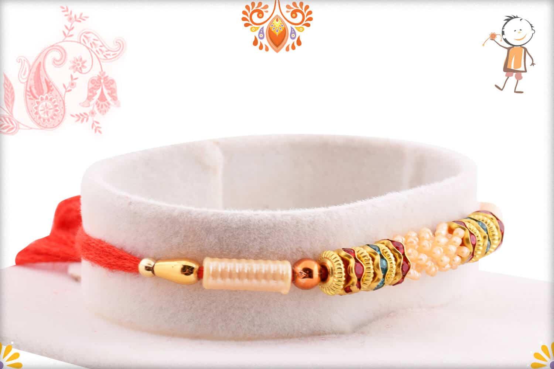 Designer Pearls Rakhi with Diamond Rings 2