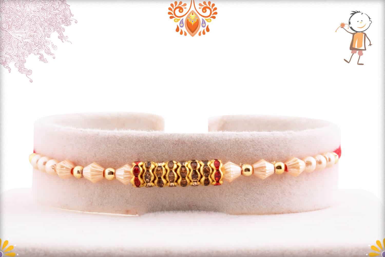 Stunning Diamond Rings with Designer Pearl Rakhi 1
