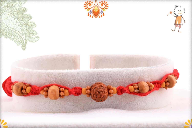 Uniquely Knotted Single Rudraksh Rakhi with Sandalwood Beads 1