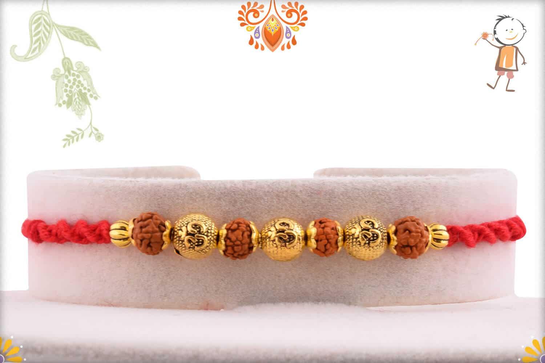 3 Engraved OM Beads with Rudraksh Rakhi   Send Rakhi Gifts Online 1