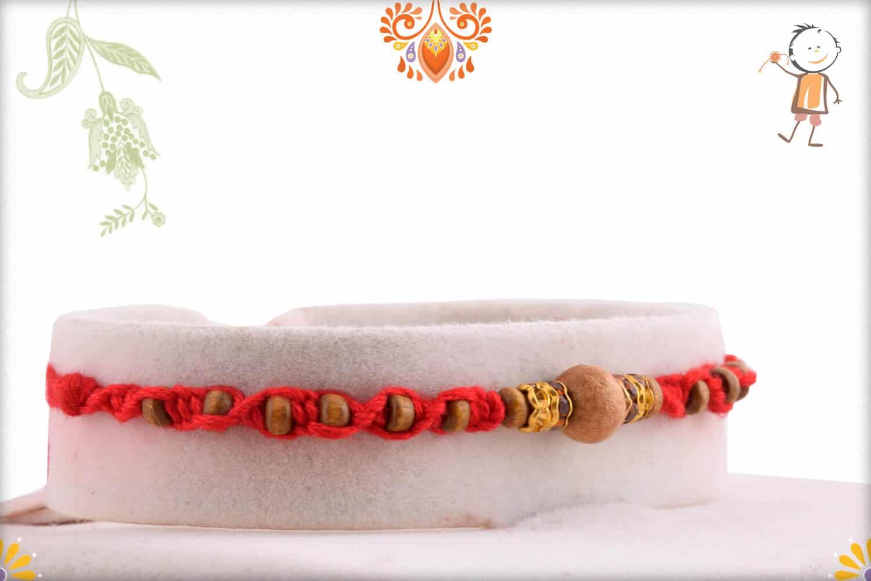 Uniquely Knotted Sandalwood Rakhi with Shining Diamonds | Send Rakhi Gifts Online 2