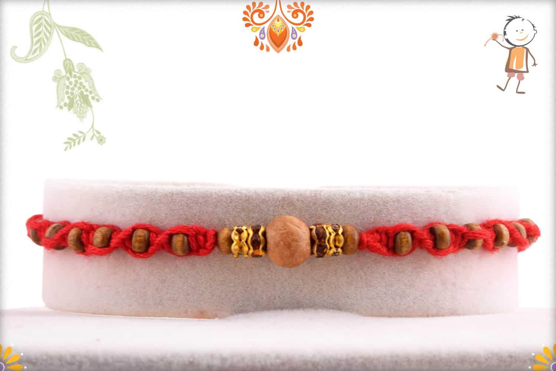 Uniquely Knotted Sandalwood Rakhi with Shining Diamonds | Send Rakhi Gifts Online 1